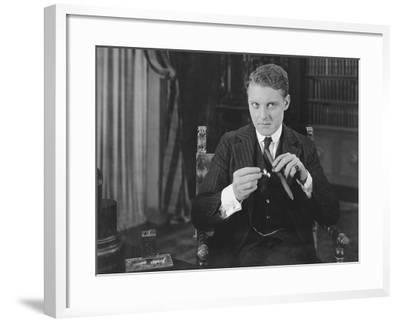 Man Lighting Cigar--Framed Photo