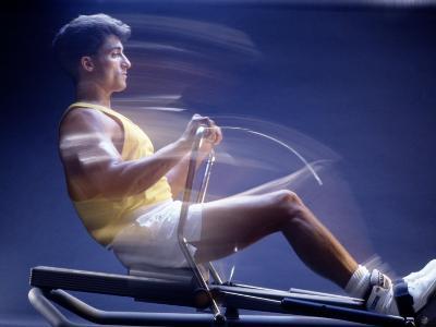 Man on Rowing Machine-Daniel Fort-Photographic Print