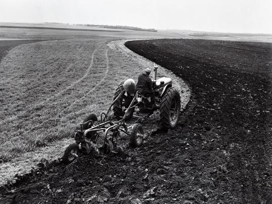 Man on Tractor Dragging Plough Through Vast Field, Rear View-H^ Armstrong Roberts-Photographic Print