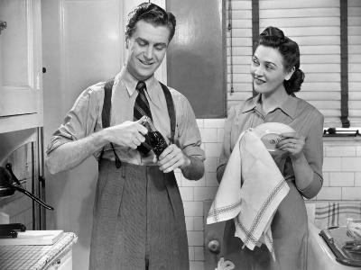 Man Opening Can of Pop, Woman Drying Dishes-George Marks-Photographic Print