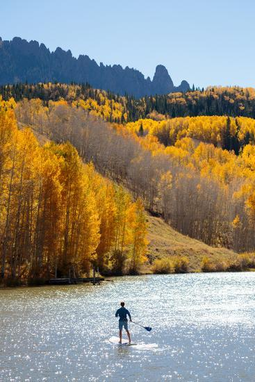 Man Paddle Boarding On Inflatable SUP Boards Near Telluride, Colorado In Autumn In The San Juan Mts-Ben Herndon-Photographic Print