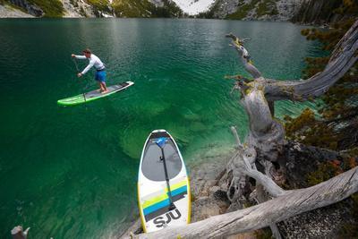 https://imgc.artprintimages.com/img/print/man-paddle-boards-using-inflatable-sup-colchuck-lake-alpine-lakes-wilderness-of-the-cascade-range_u-l-q19o2z60.jpg?p=0