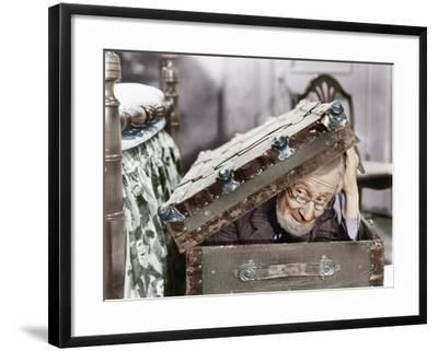 Man Peaking Out of a Trunk--Framed Photo