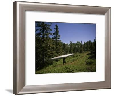 Man Portaging a Canoe along the Lake Richie Trail, Isle Royale National Park, Michigan-Phil Schermeister-Framed Photographic Print