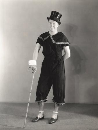 https://imgc.artprintimages.com/img/print/man-posing-in-cuffs-top-hat-and-circus-costume_u-l-q1bwe3r0.jpg?p=0