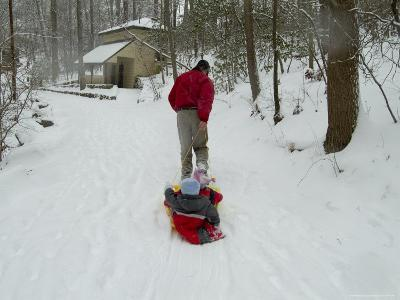 Man Pulling Two Children on a Sled Through the Snow-Todd Gipstein-Photographic Print