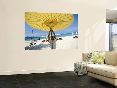 Man Putting Up Umbrella on Kamala Beach-Austin Bush-Wall Mural
