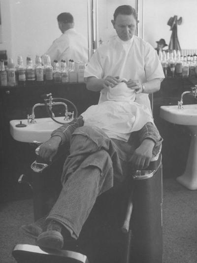 Man Receiving a Shave in a Barber Shop-Cornell Capa-Photographic Print