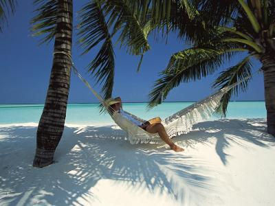 Man Relaxing on a Beachside Hammock, Maldives, Indian Ocean-Papadopoulos Sakis-Photographic Print