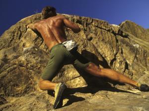 Man Rock Climbing Without Equipment