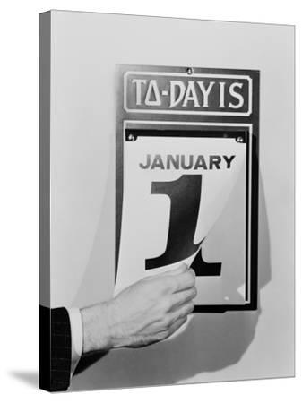 Man's Hand Tearing January 1 Page Off of Daily Wall Calendar-H^ Armstrong Roberts-Stretched Canvas Print