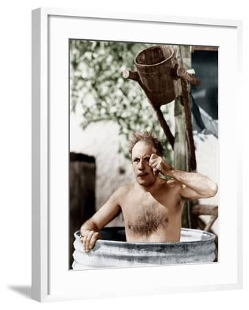 Man Sitting in a Barrel Taking a Bath and Looking Through His Monocle--Framed Photo