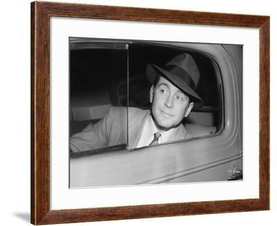 Man Sitting in a Car Looking Out the Window--Framed Photo