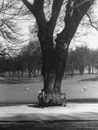 Man Sitting on a Bench and Reading a Newspaper in the Park-Cornell Capa-Photographic Print