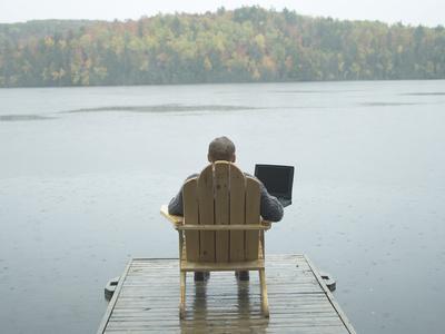https://imgc.artprintimages.com/img/print/man-sitting-on-a-dock-working-on-laptop_u-l-q10x3vp0.jpg?p=0