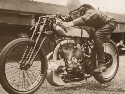https://imgc.artprintimages.com/img/print/man-sitting-on-vintage-motorcycle_u-l-q10c3320.jpg?p=0