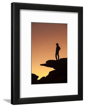 Man standing on rock surveying the view.-Brenda Tharp-Framed Photographic Print