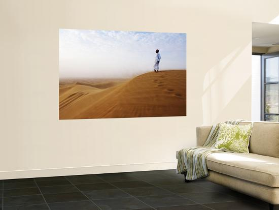 Man Standing on Sand Dune Looking Out on Arabian Desert-Christian Aslund-Wall Mural