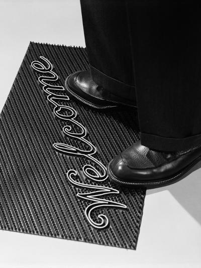 Man Stepping Onto Welcome Mat-H^ Armstrong Roberts-Photographic Print