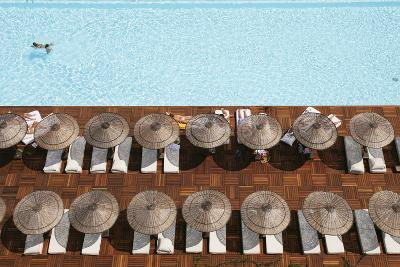 Man Swimming in Pool by Sunloungers, Aerial View-Design Pics Inc-Photographic Print