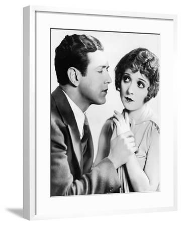 Man Trying to Kiss Uncertain Woman--Framed Photo