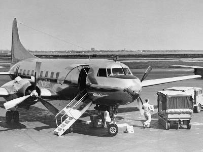 Man Unloading Cargo from Plane-George Marks-Photographic Print