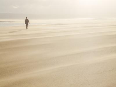 Man Walking across a Windy Beach-Craig Easton-Photographic Print