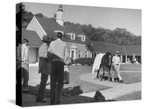 Man Walking Horse in Front of Stables at Rolling Rock Fox Hunt