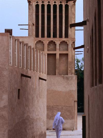 Man Walking in Lanes of Bastikia Quarter, Dubai, United Arab Emirates-Phil Weymouth-Photographic Print