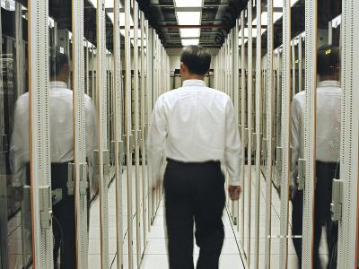 Man Walking Through a Computer Server Room-xPacifica-Photographic Print
