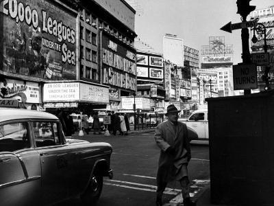 Man Walking Through Time Square-Peter Stackpole-Photographic Print