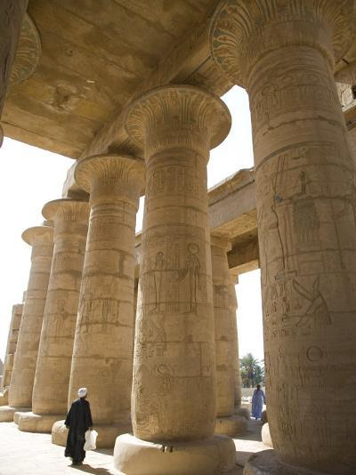 Man Walks Underneath the Giant Columns of the Hypostyle Hall in the Ramesseum, Luxor-Julian Love-Photographic Print