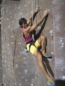 Man Wall Climbing Indoors
