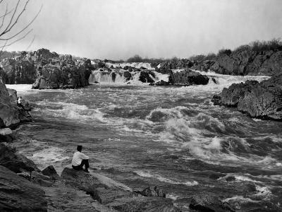 Man Watches as the Potomac River Rushes by Him-Edwin L^ Wisherd-Photographic Print