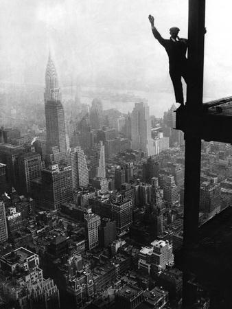 https://imgc.artprintimages.com/img/print/man-waving-from-empire-state-building-construction-site_u-l-pzlrv60.jpg?p=0