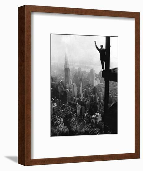 Man Waving from Empire State Building Construction Site--Framed Photographic Print