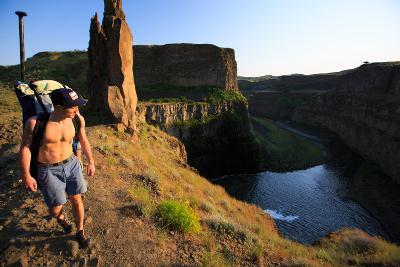 Man Wearing Inflatable SUP Pack Hikes Around Middle Tier At Palouse Falls, Sunset-Ben Herndon-Photographic Print