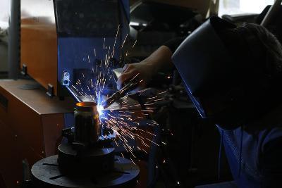 Man Welding Workpiece, Workshop, Flying Sparks- Fact-Photographic Print