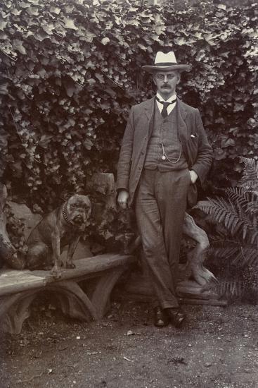Man with a Bulldog in a Garden--Photographic Print