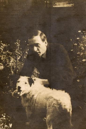 Man with a Terrier in a Garden--Photographic Print
