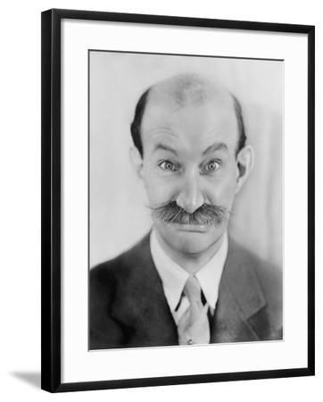 Man with Mustache Making a Funny Face--Framed Photo