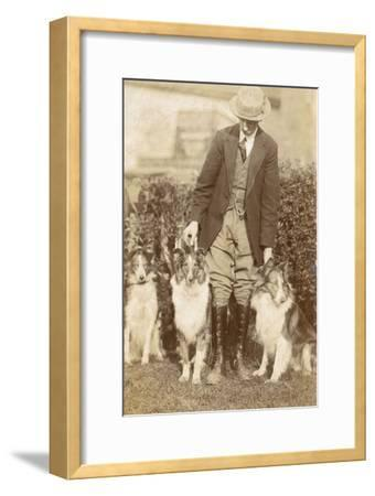 Man with Three Dogs in a Garden