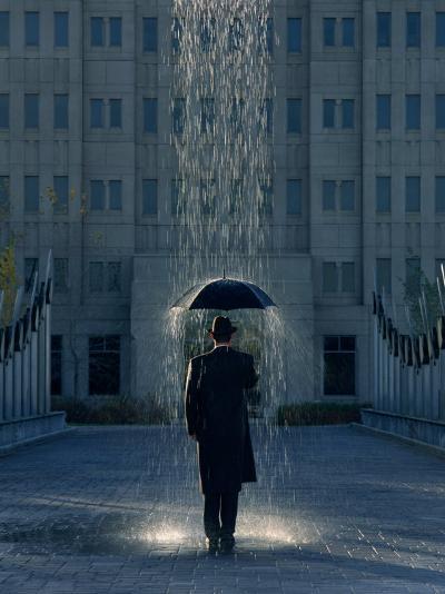 Man with Umbrella Under a Regional Rain-Joseph Hancock-Photographic Print