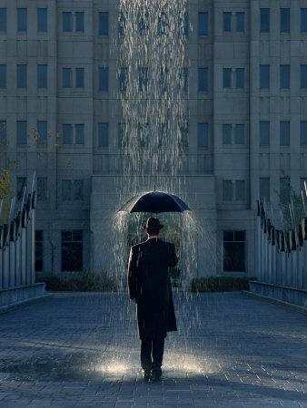 https://imgc.artprintimages.com/img/print/man-with-umbrella-under-a-regional-rain_u-l-p3j1qu0.jpg?p=0