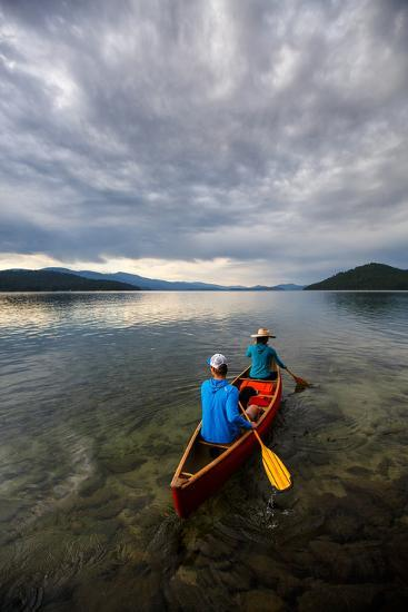 Man & Woman Paddle A Canoe While Shilo The Dog Enjoys The Ride At Sunrise On Priest Lake In N Idaho-Ben Herndon-Photographic Print
