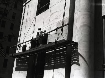 Man Working on Platform Hanging From Building-George Marks-Photographic Print