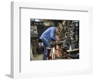 Man Works in his Shop on a Family Farm in Nebraska-Joel Sartore-Framed Photographic Print