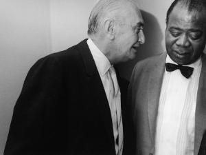 Manager Joe Glaser Conferring with Client, Musician Louis Armstrong, after a Concert