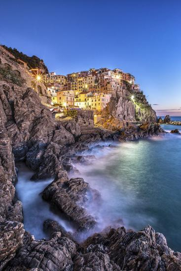 Manarola Village Illuminated by the Blue Light of Dusk with its Typical Pastel Colored Houses-ClickAlps-Photographic Print