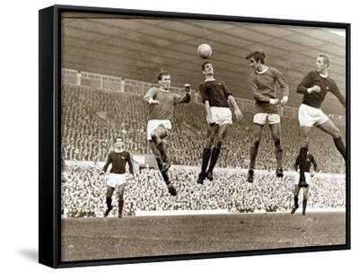 Manchester United vs. Arsenal, Football Match at Old Trafford, October 1967--Framed Canvas Print